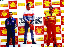 Pavlovic, Giorgio Pantano and Jenson Button on the podium in Suzuka, Japan.