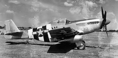 North American P-51D-5-NA Mustang Serial 44-13404 (CV-Z) of the 368th Fighter Squadron painted in D-Day Invasion markings, June 1944. The pilot of this aircraft, Lt. Louis E. Barnett was killed on 12 September 1944.