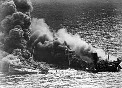 "An Allied tanker {""Dixie Arrow""} torpedoed in the Atlantic by a German U-boat."