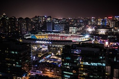 Beijing Workers' Stadium at night as viewed from Sanlitun