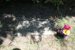 "Bonnie Parker's grave, inscribed: ""As the flowers are all made sweeter by the sunshine and the dew, so this old world is made brighter by the lives of folks like you."" 32°52′03″N 96°51′50″W / 32.867416°N 96.863915°W / 32.867416; -96.863915 (Burial site of Bonnie Elizabeth Parker)"