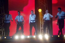 Boyzone performing on tour with Ronan Keating as the lead singer.