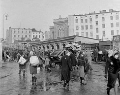 Resettlement of Jews to the Ghetto area c. March 1940. Old Synagogue in the far background (no longer existing)