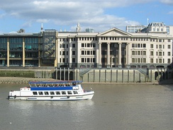 Cruise boat Chay Blyth on the Thames in front of Vintners' Place.