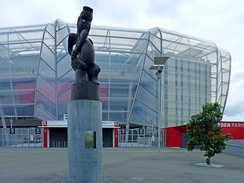 Eden Park stadium with statue of Rongomātāne