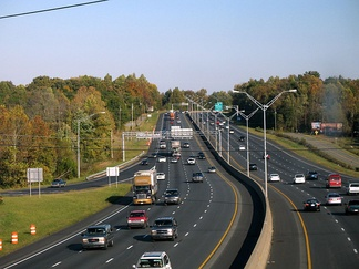 Interstates 85 and 40 run concurrently as seen from Exit 141 in Burlington, facing east.  The Interstates run east to west through the central part of the county.