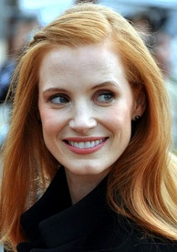 Jessica Chastain smiles while she gently looks away from the camera