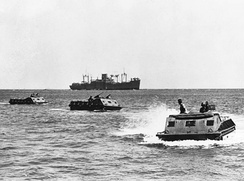 LVT-1 move toward the beach on Guadalcanal. The USS President Hayes (AP-39) is seen in the background.