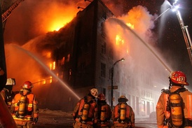 Firefighters tackling a blaze in Montreal, Canada