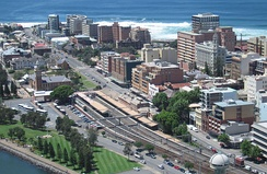 Newcastle's East End in 2008 with Newcastle railway station in the centre. The buildings at right are within the Dangar Grid, designed in 1823.