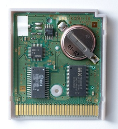 "An opened Game Boy cartridge with battery-backed volatile memory for game saves. Measures 2.2"" × 2.56"" × 0.32"" (or 56 mm × 65 mm × 8 mm)"