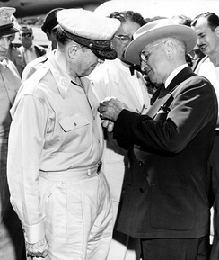 President Harry S. Truman awards the Distinguished Service Medal, Fourth Oak Leaf Cluster, to Gen. Douglas MacArthur during the Wake Island Conference.