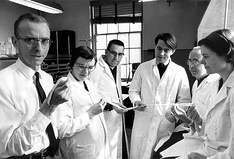 Robert W. Holley, left, poses with his research team.