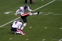 Chicago Bears punter Brad Maynard (#4) holds for placekicker Robbie Gould.