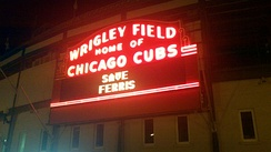 Wrigley Field at night lit up to say 'Save Ferris'