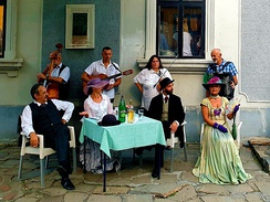 Serbian Folk Group, Music and Costume. A group of performers sharing traditional Serbian folk music on the streets of Belgrade, Serbia.