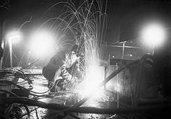 A burner operating at night on the deck of a ship at Harland and Wolff's Liverpool yard (27 October 1944).