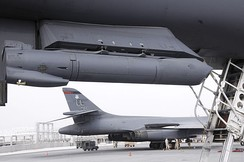 A Sniper Advanced Targeting Pod hangs from the underbelly of a B-1B Lancer