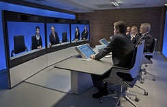 A Tandberg T3 high-resolution telepresence room in use (2008)