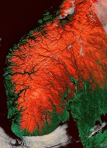 Satellite image of southern Norway, higher areas shown in red. Sognefjorden and Hardangerfjorden are visible in the west, Oslofjord is seen in the southeast. Trondheimsfjord (some white clouds) is in the north, with Hitra and Frøya islands at the mouth.