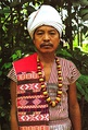 A Karbi man of West Karbi Anglong in traditional attire, wearing a Poho (white turban), a choi-hongthor (woven jacket), a lek paikom (gold-plated necklace) and another poho on his right shoulder.