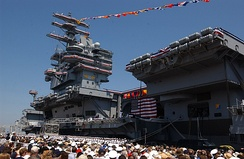 "Hundreds attend the commissioning ceremony for the nuclear-powered aircraft carrier USS Ronald Reagan. Nancy Reagan, wife of the ship's namesake, gave the ship's crew its traditional first order as an active unit of the Navy: ""Man the ship and bring her to life."""