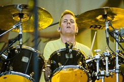 Brann Dailor's (pictured) fill-heavy drumming style is influenced by jazz and progressive rock, characterized by complex, atypical rhythmic structures (including irregular stopping and starting). He also attributes his style to band practice as a teenager, claiming that practicing with the guitarist instead of the bassist influenced his style.