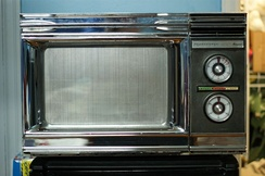 "1974 Radarange RR-4. By the late 1970s, technological advances led to rapidly falling prices. Often called ""electronic ovens"" in the 1960s, the name ""microwave oven"" later gained currency, and they are now informally called ""microwaves""."