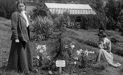 Annie Kenney and Adela Pankhurst, pictured here in 1909 aside a tree planted by Emmeline Pankhurst