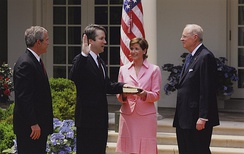 Kavanaugh is sworn into the D.C. Circuit by Justice Anthony Kennedy as his wife holds the bible and President Bush looks on, 2006. Coincidentally, Kavanaugh would be sworn into the U.S. Supreme Court 12 years later as Kennedy's replacement.