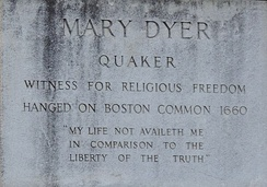Inscription under statue of Mary Dyer at Massachusetts Statehouse, Boston, Mass.  Note that the place given of her hanging is erroneous.