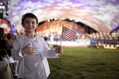 A boy holds an American flag during the 2009 National Memorial Day Concert in Washington, D.C.