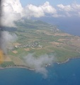Flying towards the north end of the island, looking down part of the west or Caribbean coast