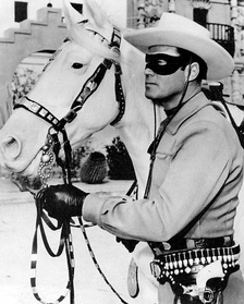"The Lone Ranger; a famous heroic lawman who was with a cavalry of six Texas Rangers, until they were all killed but him.  He preferred to remain anonymous, so he resigned and built a sixth grave that supposedly held his body.  He fights on as a lawman, wearing a mask, for, ""Outlaws live in a world of fear.  Fear of the mysterious."""
