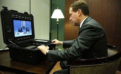 Russian President Dmitry Medvedev attending the Singapore APEC summit, holding a videoconference with Rashid Nurgaliyev via a Tactical MXP, after an arms depot explosion in Russia (2009)