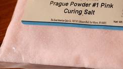 "Bag of Prague powder #1, also known as ""curing salt"" or ""pink salt."" It's typically a combination of salt and sodium nitrite, with the pink color added to distinguish it from ordinary salt."