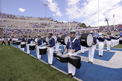 The United States Air Force Drum and Bugle Corps performing at Falcon Stadium during a USAFA football game against Idaho State University.