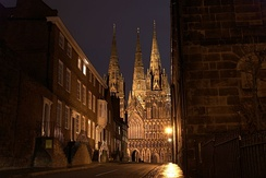 The entrance to Cathedral Close at night, with Lichfield Cathedral in the background