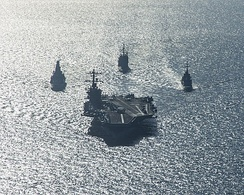 USS Carl Vinson and support ships deployed for combat operations in Syria and Iraq.