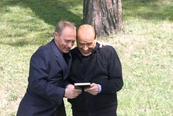 Putin with Italian Prime Minister Silvio Berlusconi. The two leaders built up a close friendship