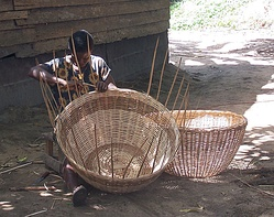 A woman weaves a basket in Cameroon