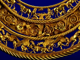 Gold pectoral, or neckpiece, from a royal kurgan in Tolstaya Mogila, Pokrov, Ukraine, dated to the second half of the 4th century BC, of Greek workmanship. The central lower tier shows three horses, each being torn apart by two griffins. Scythian art was especially focused on animal figures.