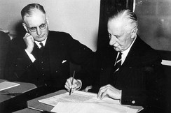 Governor General of Australia The Lord Gowrie (right) signing the declaration of war against Japan with Prime Minister John Curtin (left) looking on. (8 December 1941)
