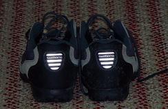 Retroreflectors on a pair of bicycle shoes. Light source is a flash a few centimeters above camera lens.