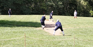 "A 2005 vintage base ball game, played by 1886 rules. Vintage games are live contests that seek to portray the authenticity of the early game. (The term ""reenactment"" is a common misnomer; games are contested and not meant to recreate a specific historical event.)"