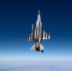 View of underside of F-16 during a vertical climb