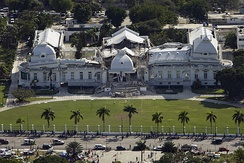 The Presidential Palace (National Palace) in Port-au-Prince on 13 January 2010, the day after the 2010 earthquake, showing the extensive damage to the edifice.