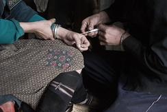 A drug user receiving an injection of the opiate, heroin