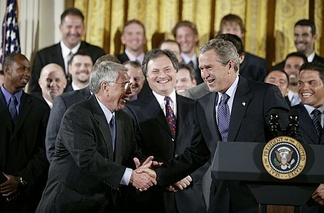 Members of the 2003 Florida Marlins championship team with President Bush after their win.