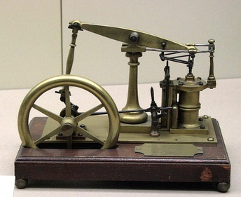 A model of a beam engine featuring James Watt's parallel linkage for double action.[a]
